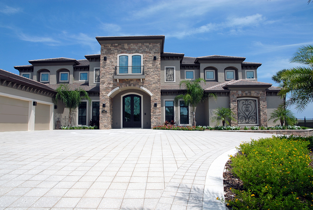 Large home with custom driveway and three car garage