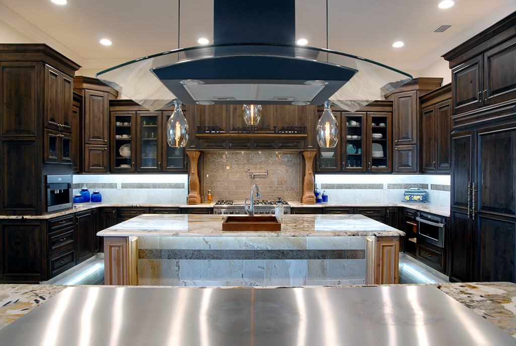 Kitchen island with gas stove and dark cabinets