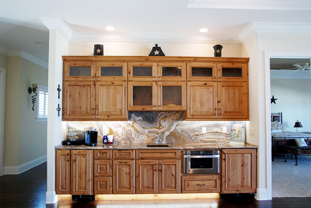 Kitchen with wood cabinets and marbleized back splash