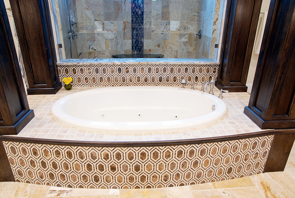 Jetted tub and walk in shower with unique pattern