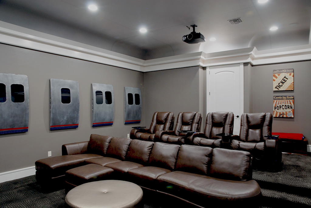 Home theater room with leather seating