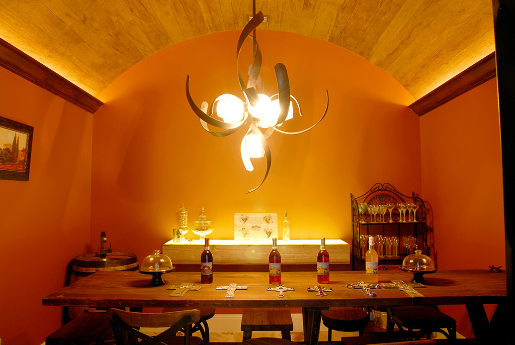 Orange dining room with metal twisty chandelier