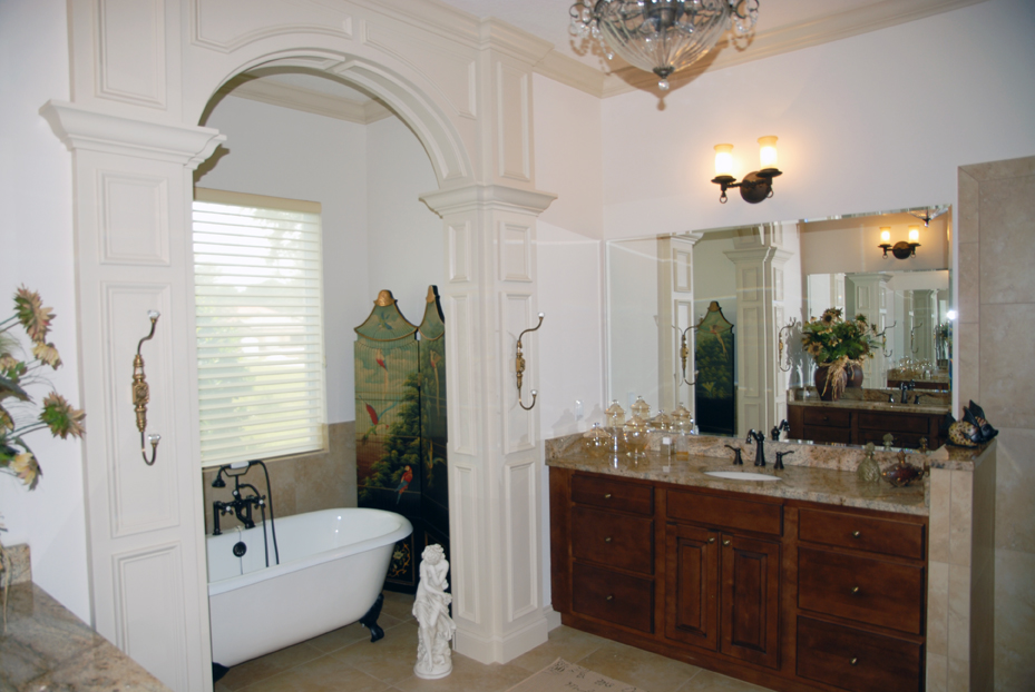Master bathroom with single vanity sink and claw foot bathtub