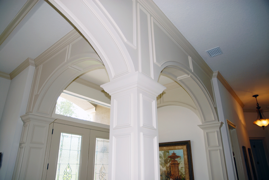 Top of entryways with arch detail in white.
