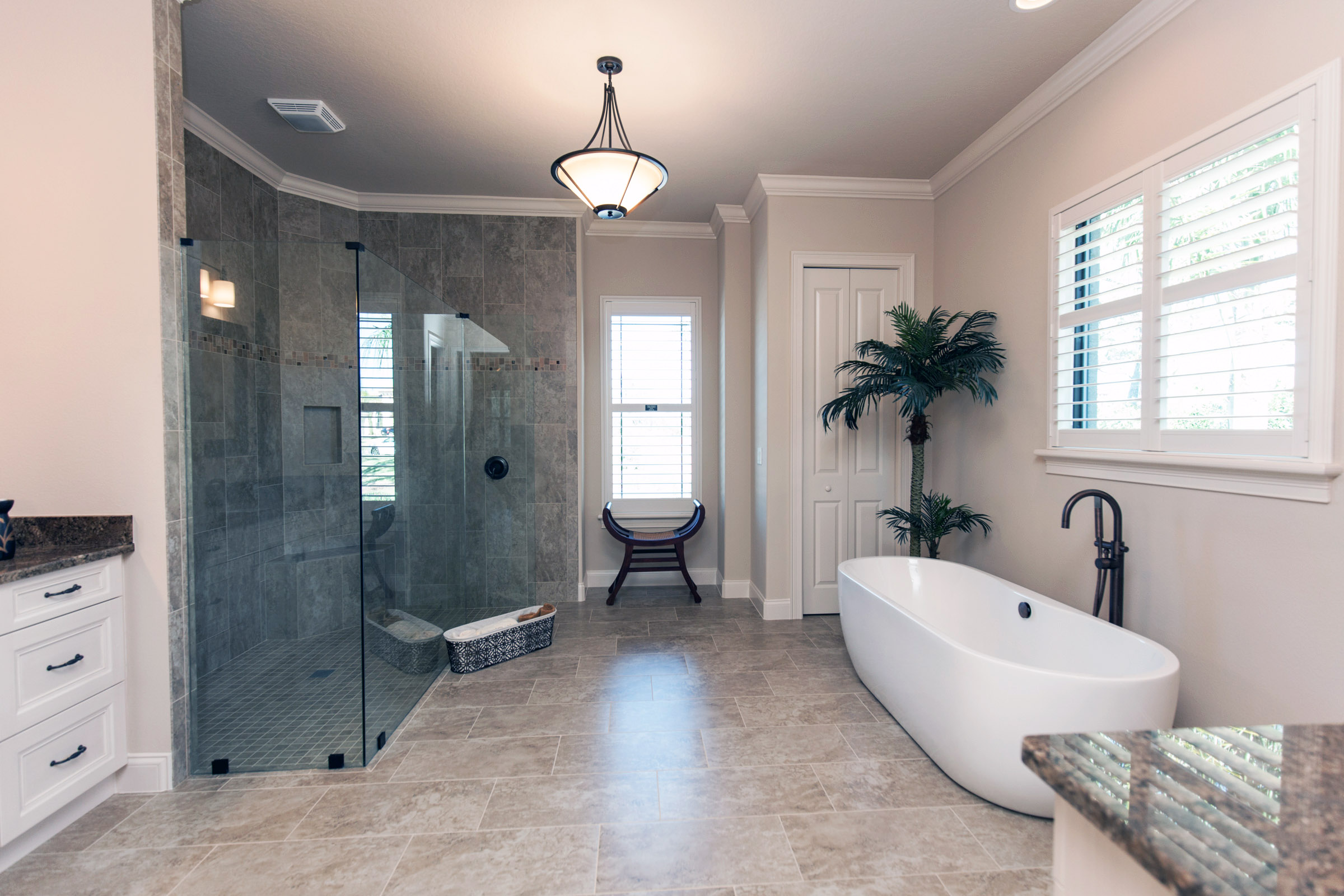 Master bathroom with glass walk in shower and large soaking tub