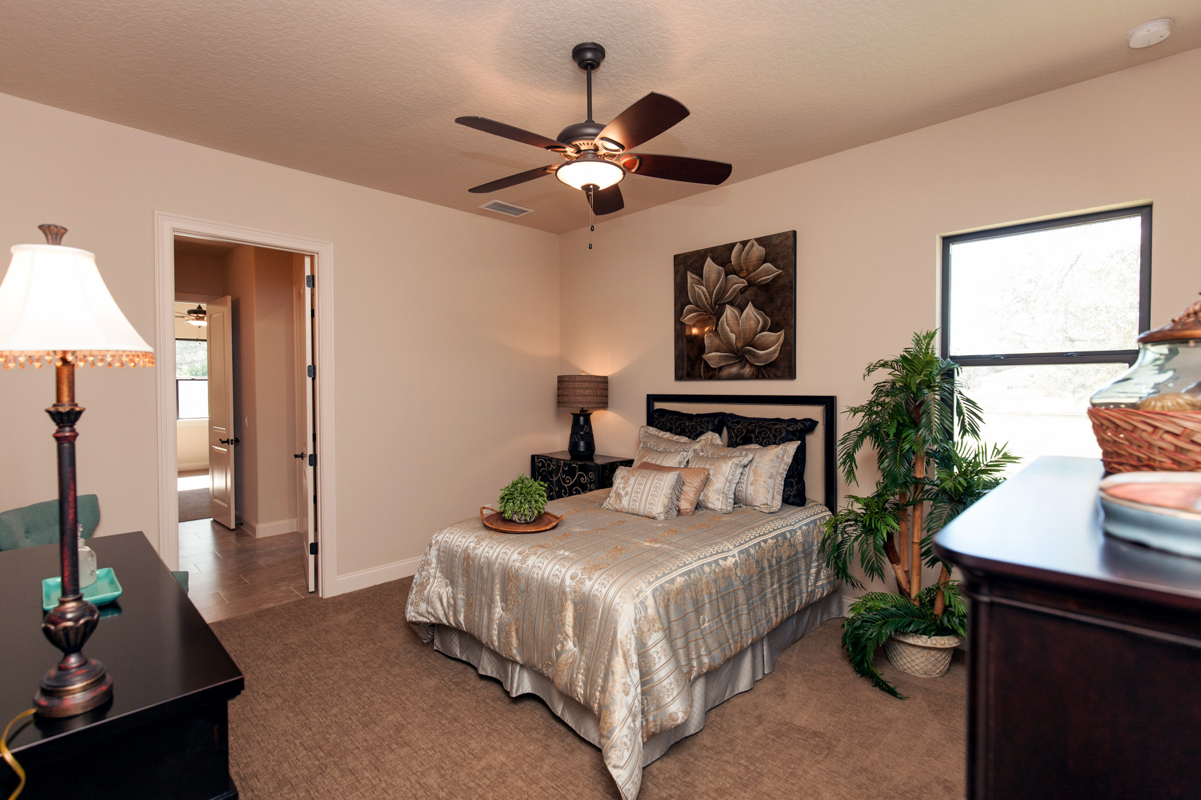 Beige bedroom with silk bedding on a full size bed