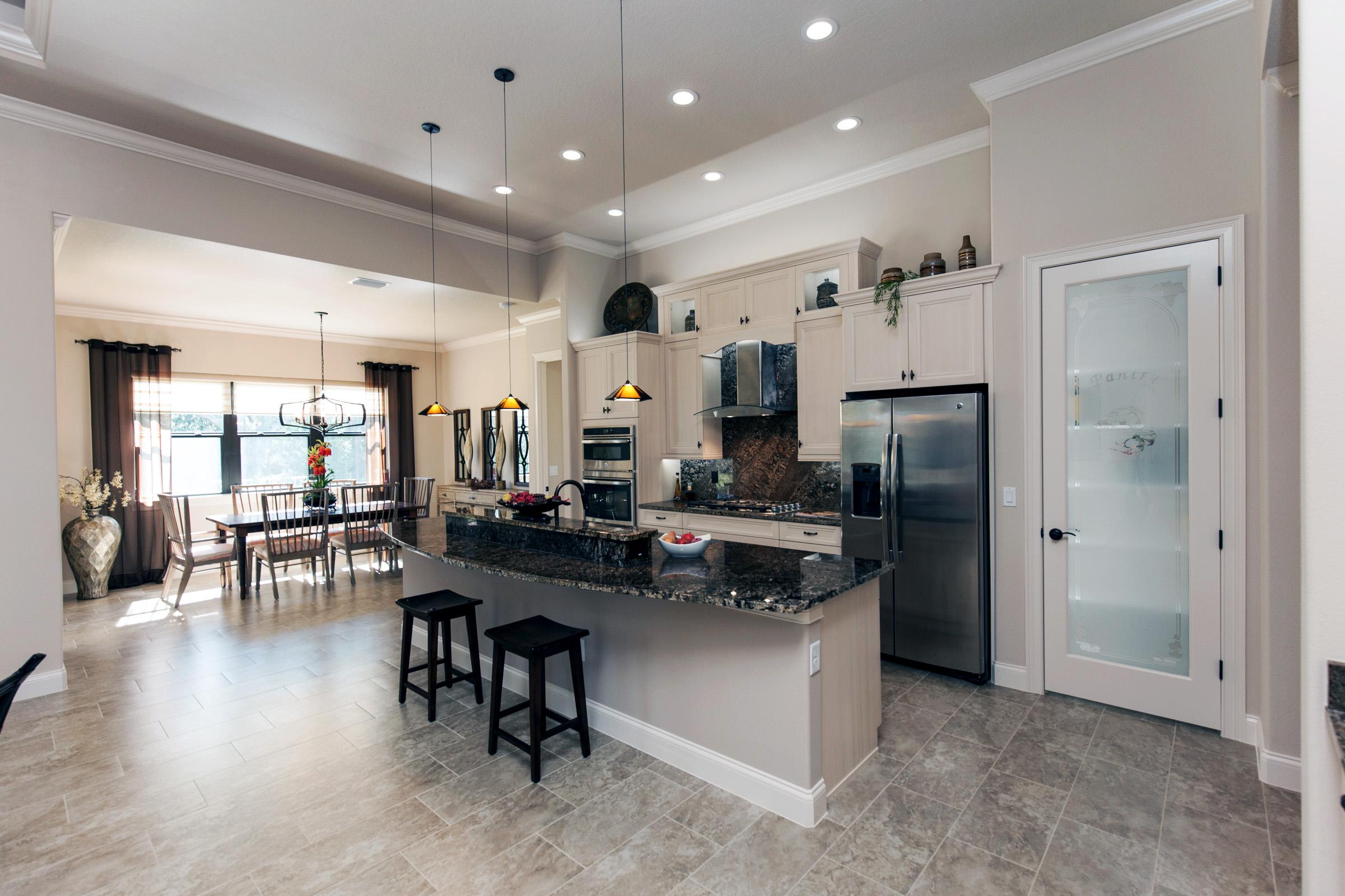 Kitchen with windowed pantry door.