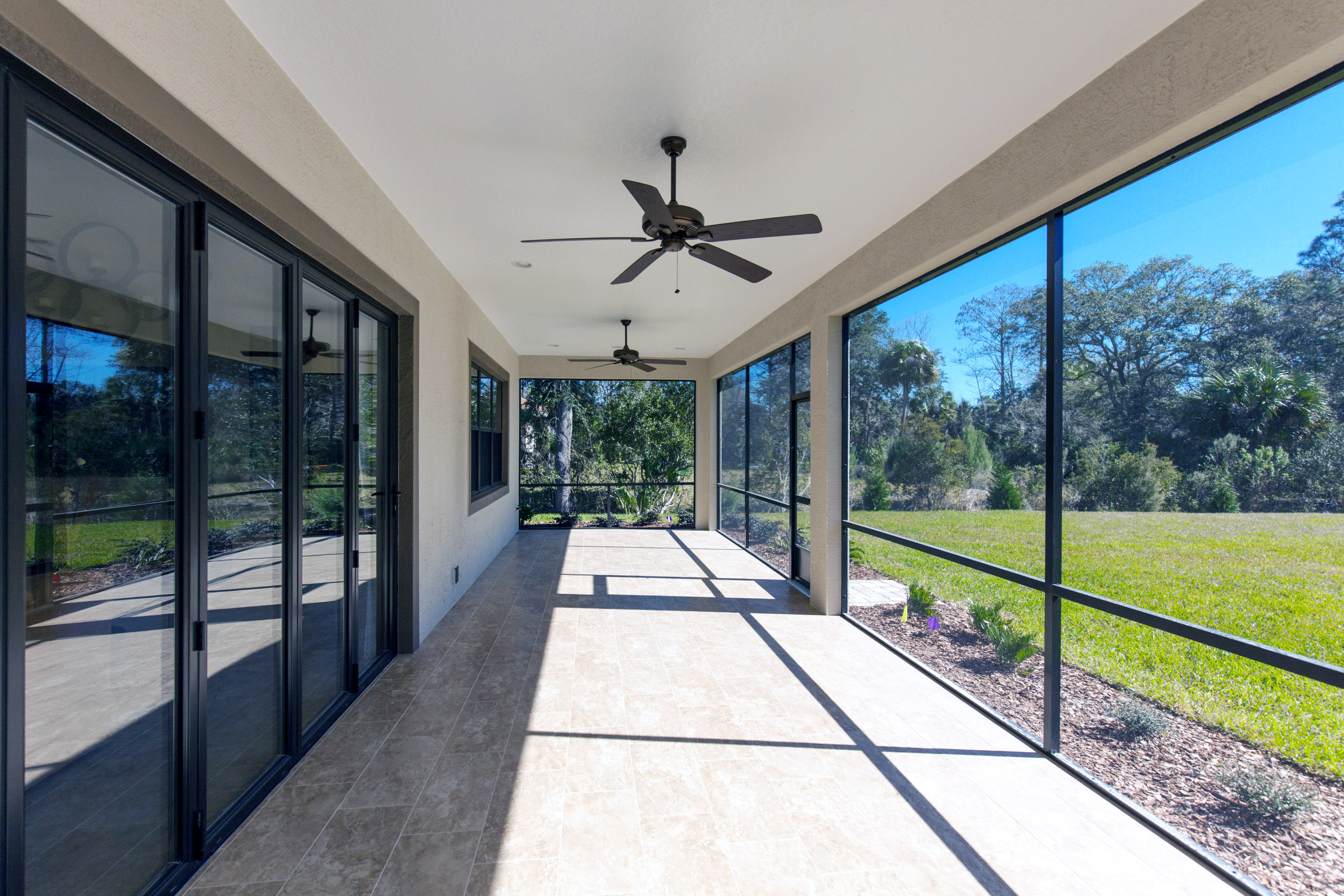 Large closed in lanai with ceiling fans