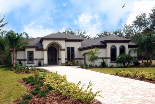 Custom built home with light exterior and contrasting dark trim