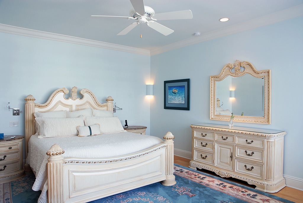 Light blue bedroom with corner and recessed lighting