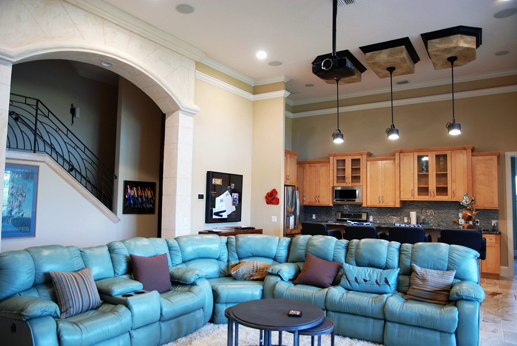 Living and kitchen area with large blue sectional couch