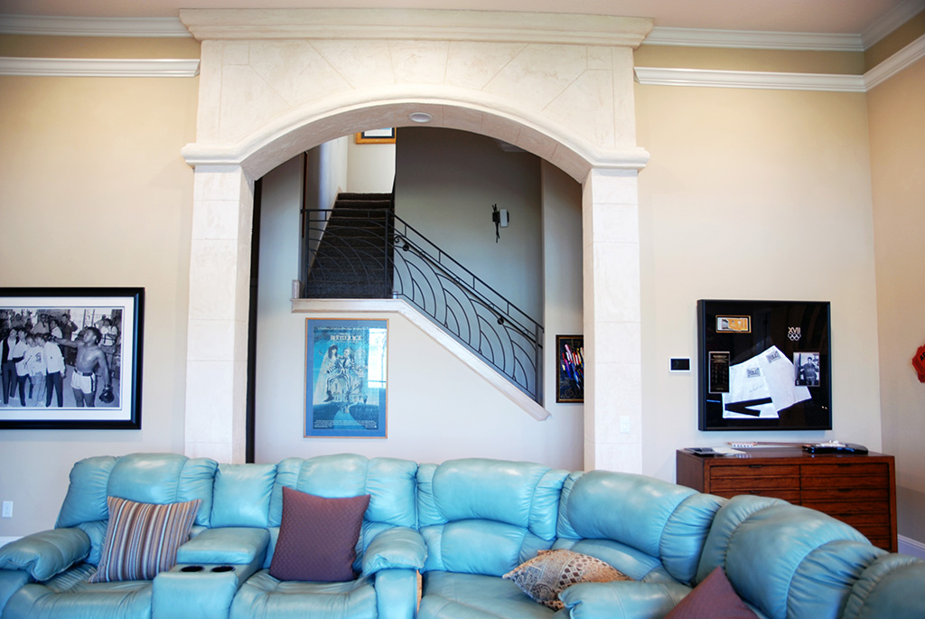 Sectional couch in living are with arch entryway