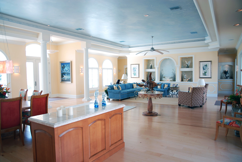 Custom open floor plan including dining table, living room and modest kitchen island
