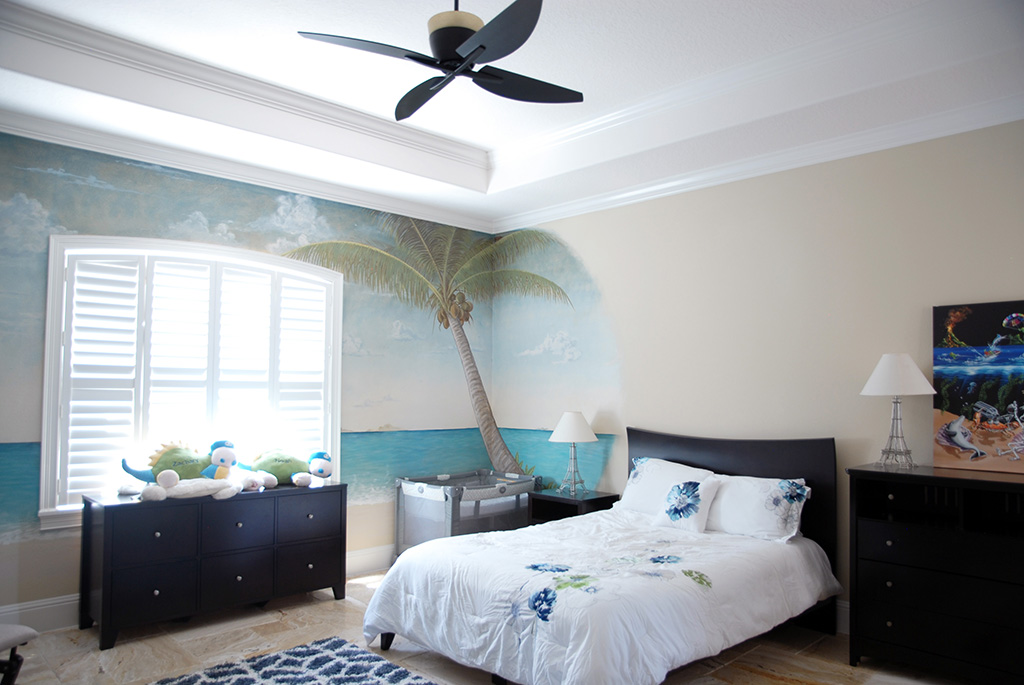 Bedroom with ocean mural and full size bed