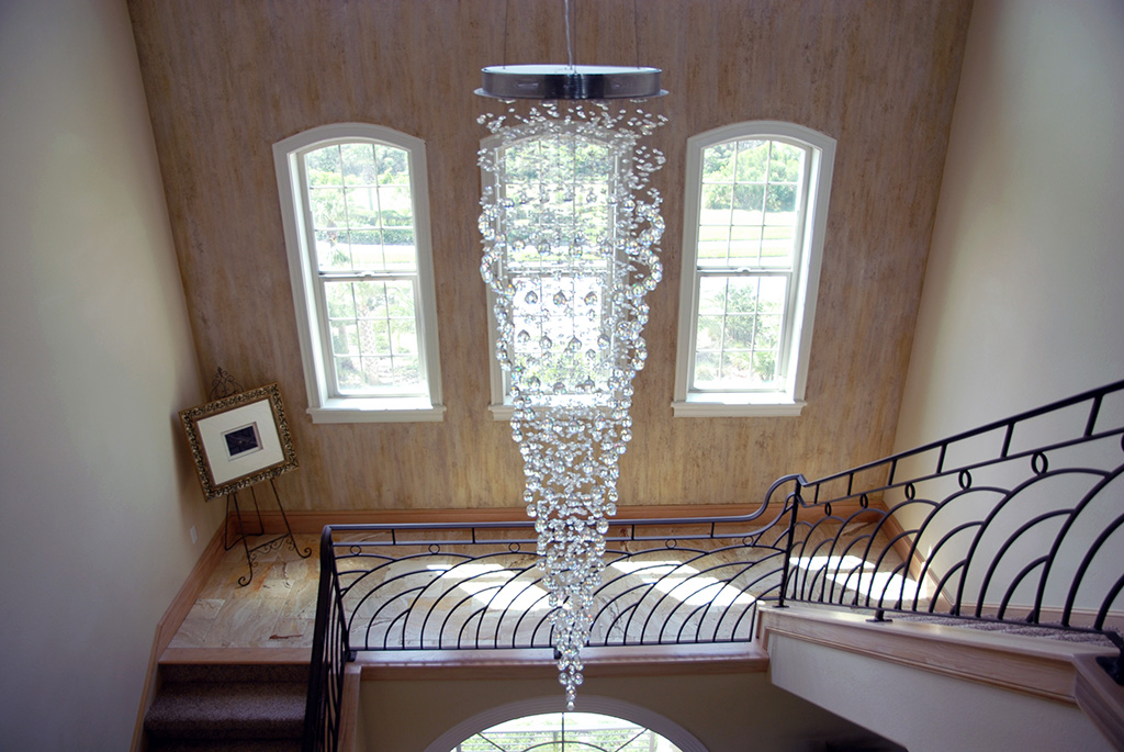 Glass ball chandelier in the middle of a stair case
