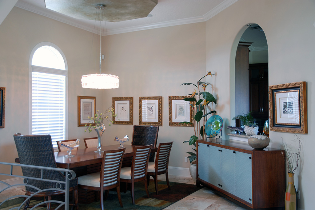 Formal dining area with arch wall cut out