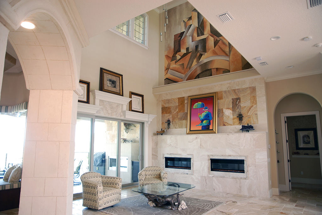 Marble entryway with recessed lighting and dual fireplaces