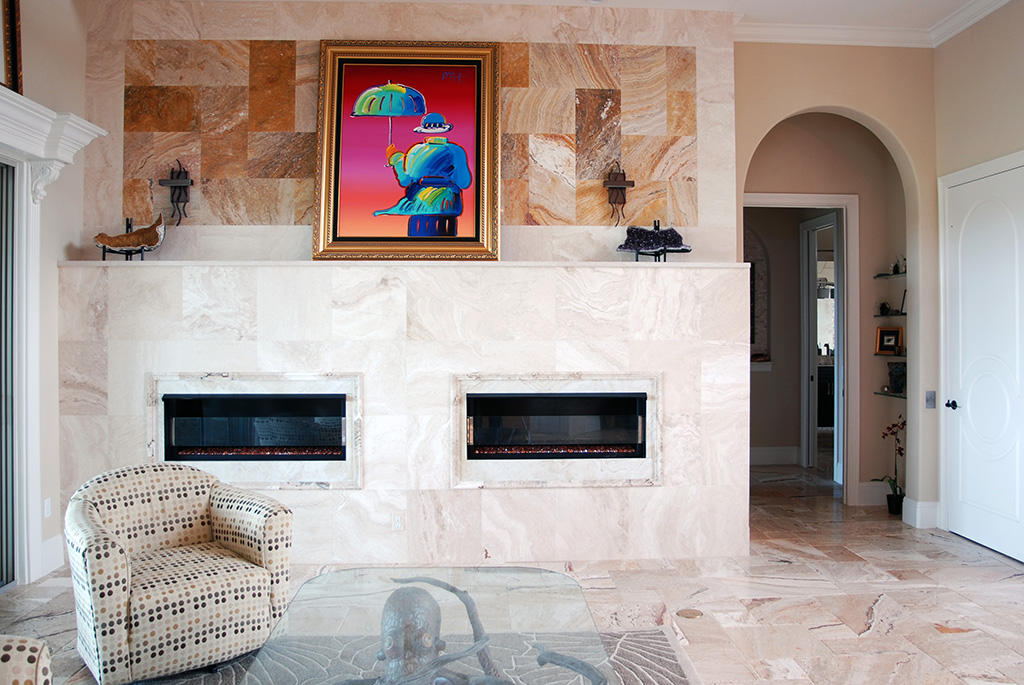 Dual fireplaces with marble floor and wall