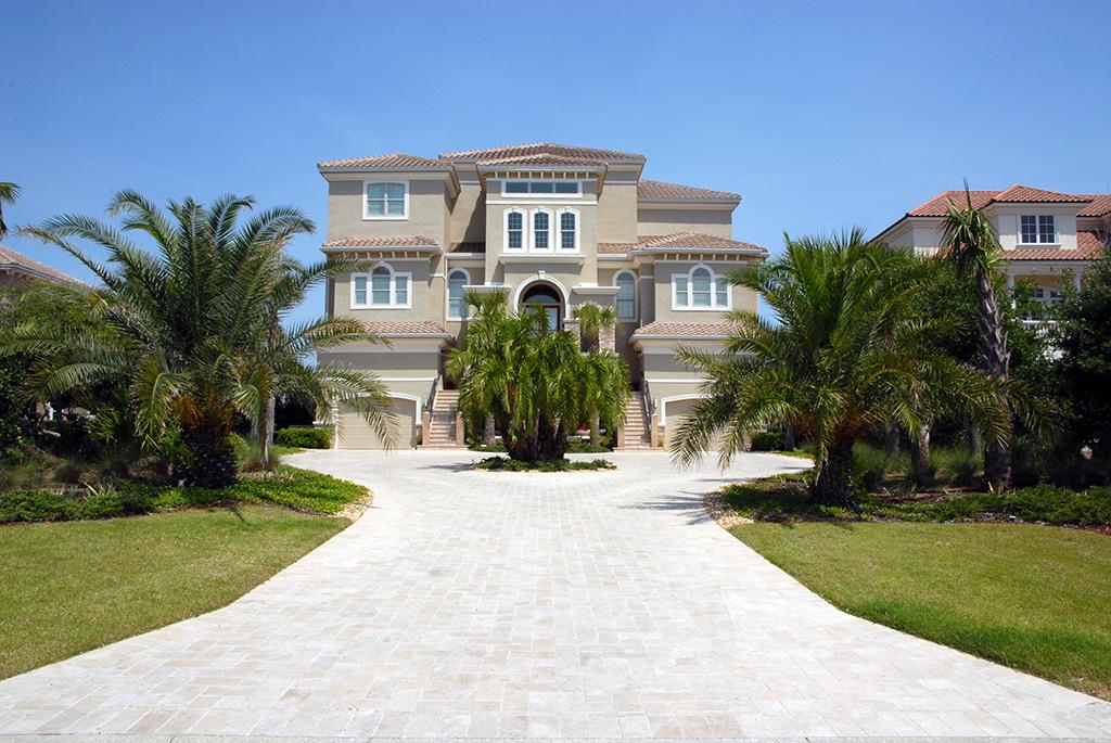 Custom driveway leading to 3 story custom home