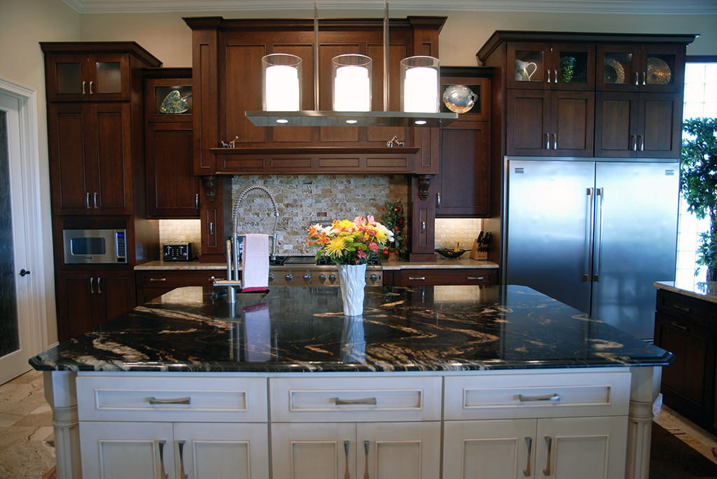 Kitchen with dark storage cabinets and large kitchen island.