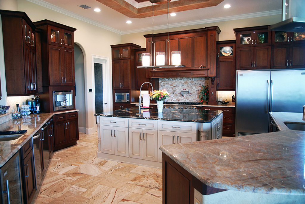 Kitchen with dark wood cabinets and white center island