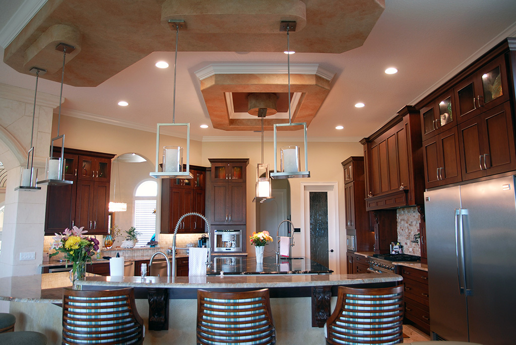 Kitchen with unique ceiling details and stainless steel appliance