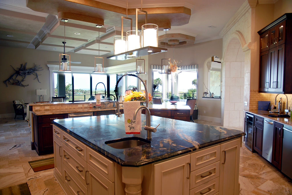 Kitchen island with marble top and sink.