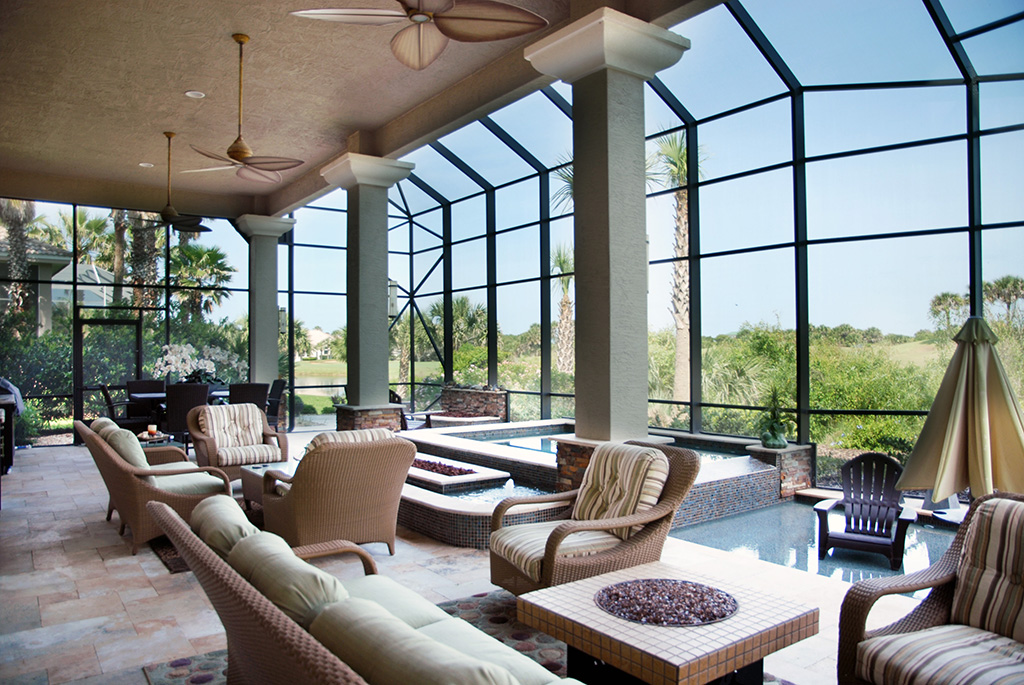 Large glassed in living area with pool and living space
