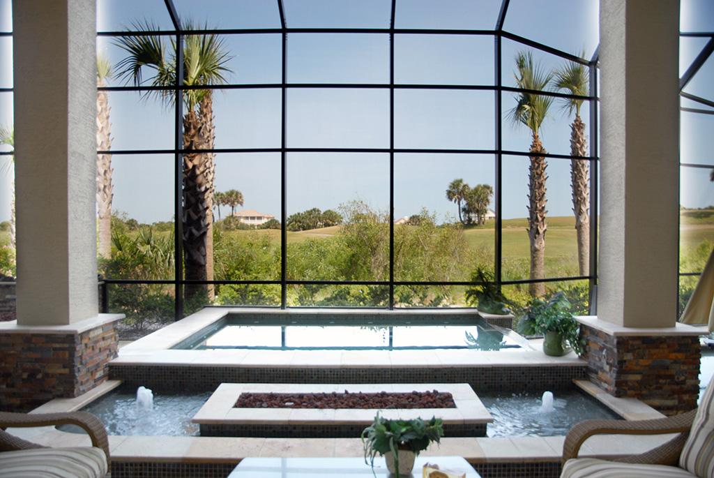 Floor to ceiling windows surrounding an indoor pool