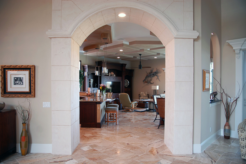 Arched tile open entry way to kitchen and living area