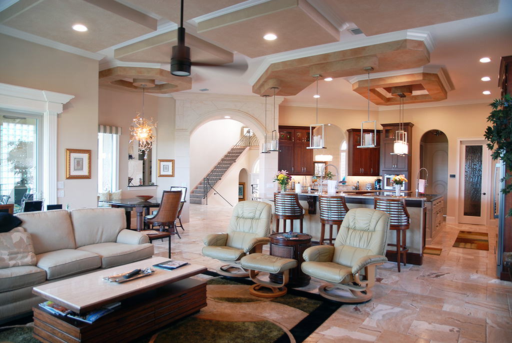 Open living space with living room, kitchen and dining space with ceiling details