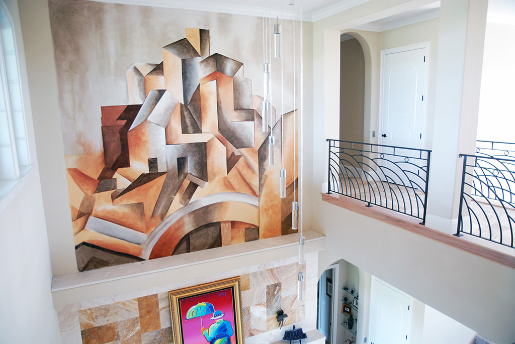 Geometric artwork overlooking a large open floor plan with catwalk.