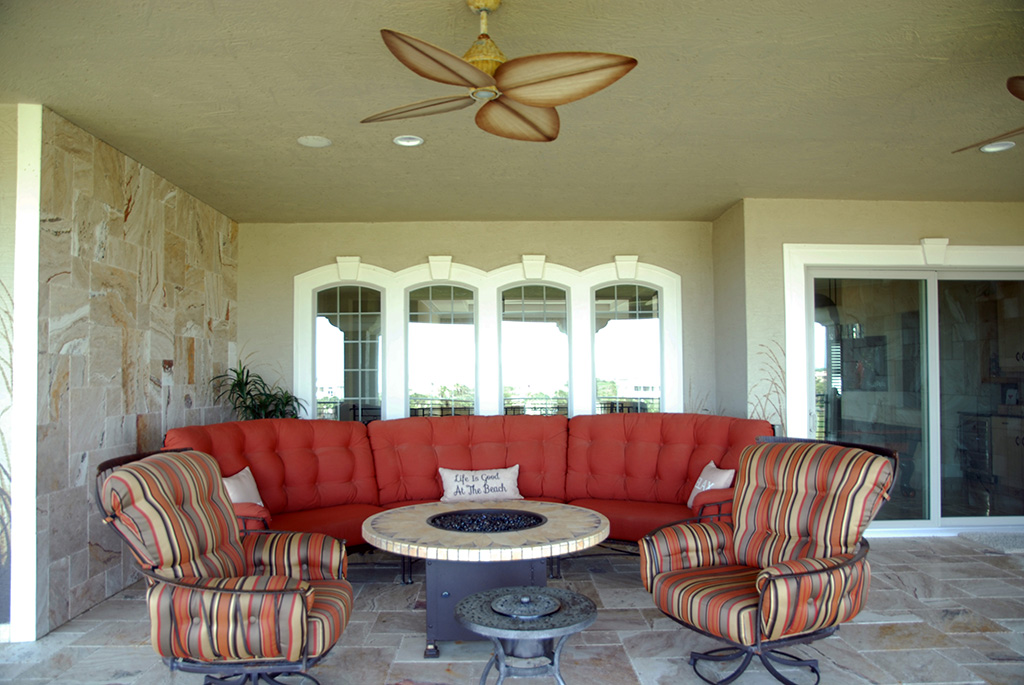 Marble tile outdoor patio with matching marble wall and conversation furniture
