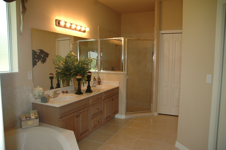 Bathroom with double vanity, oversized shower and soaking tub
