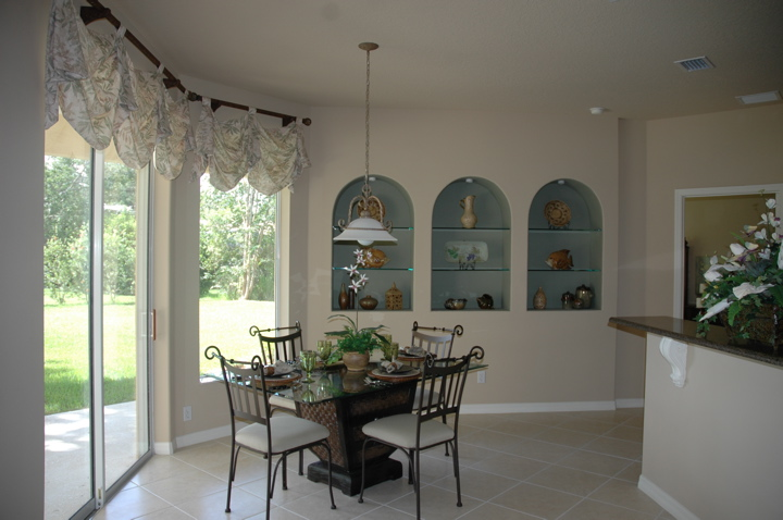 Breakfast nook with sliding glass doors opening to the back yard