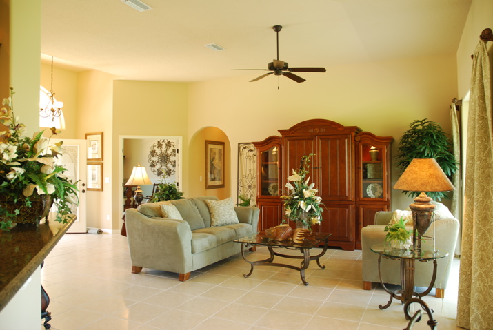 Custom home with large living area outfitted with modern furniture and high ceilings
