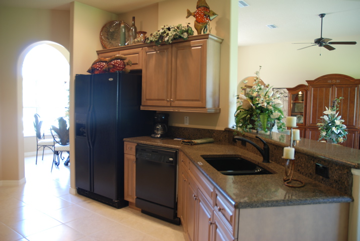 Custom built kitchen with opening to living room for an open concept feel