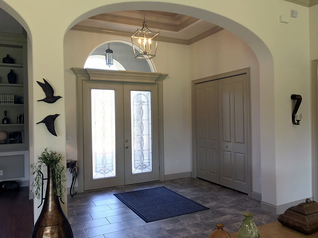 Custom built entryway including french doors with inset windows