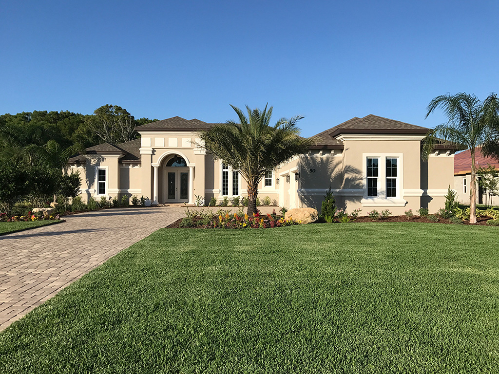 Beautiful custom home front designed and built by Skyway builders