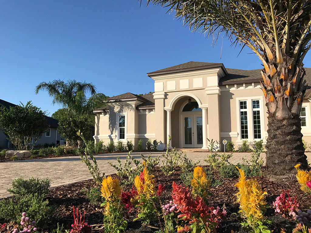 Front view of custom home with custom landscaping