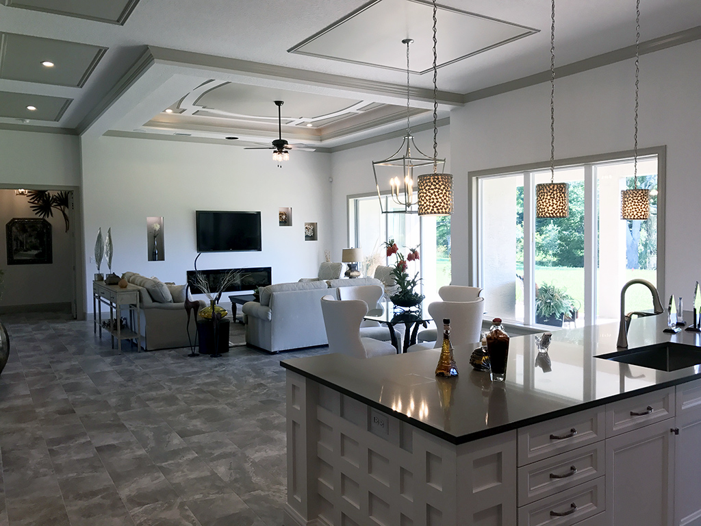 Kitchen island with marble counter top and living room