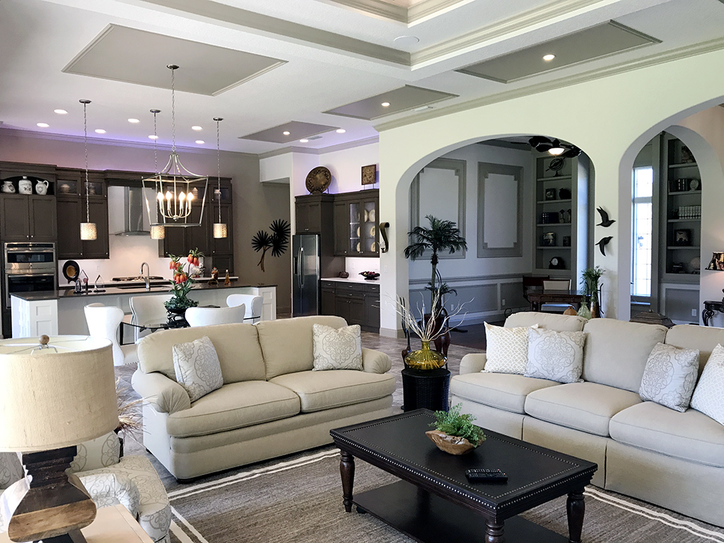 Image of a custom home with open floor plan including kitchen, sitting room, and study