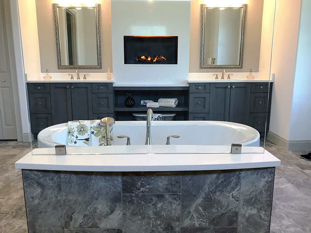 Large soaking tub with separated double vanity
